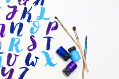 Calligraphy lettering alphabet drawn with dry brush. Letters of English ABC written with paint brush royalty free stock image