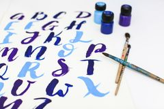 Calligraphy lettering alphabet drawn with dry brush. Letters of English ABC written with paint brush royalty free stock photos