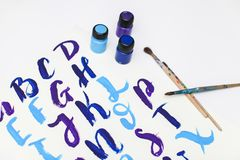 Calligraphy lettering alphabet drawn with dry brush. Letters of English ABC written with paint brush stock photos