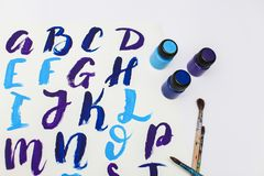 Calligraphy lettering alphabet drawn with dry brush. Letters of English ABC written with paint brush royalty free stock images