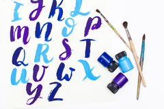 Calligraphy lettering alphabet drawn with dry brush. Letters of English ABC written with paint brush. Concept hobby or education stock image