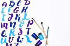 Calligraphy lettering alphabet drawn with dry brush. Letters of English ABC written with paint brush. Concept hobby or education royalty free stock photos