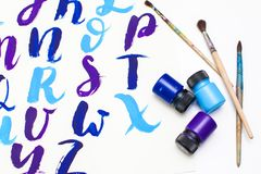 Calligraphy lettering alphabet drawn with dry brush. Letters of English ABC written with paint brush. Concept hobby or education royalty free stock image