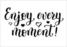 Calligraphy lettering of motivational phrase `Enjoy every moment` in black Stock Image