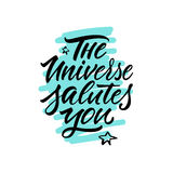 Calligraphy. Lettering. Phrase: `The Universe Salutes You.` Royalty Free Stock Image