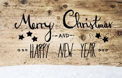 Calligraphy Merry Christmas And Happy New Year, Wooden Background, Snow Royalty Free Stock Photography
