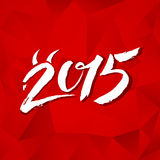 Calligraphy New Year sign on red triangles Stock Photo