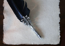 Calligraphy pen and handmade paper with scalloped edges Stock Image