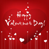 Calligraphy pen: Happy valentine's day with decorative hearts Stock Photos