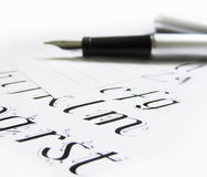 Calligraphy pen, letters. In a book royalty free stock photography