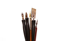 Calligraphy Pens, Isolated. The tops of calligraphy tools and drawing pens, isolated on white background Royalty Free Stock Images