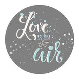 Calligraphy phrase- Love is in the air. Romantic design for card, postcard or poster. Calligraphy phrase- Love is in the air Royalty Free Stock Photo