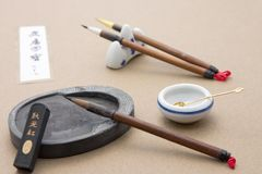 Calligraphy set. Traditional calligraphy set displayed on paper Royalty Free Stock Image