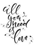 Calligraphy sign- All you need is love with splatters. Black and white. Calligraphy sign- All you need is love with splatters Royalty Free Stock Images