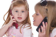 Calling. Mother and daughter on the phone, isolated on white Royalty Free Stock Photography