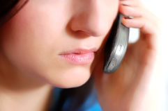 Calling. Isolated woman face while speaking to the phone Royalty Free Stock Photos
