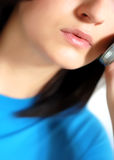 Calling. Isolated woman face while speaking to the phone Stock Images
