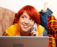 Calling. Young happy woman is calling on the phone Stock Photo