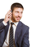 Calling. Portrait of smiling boss calling by phone on a white background Royalty Free Stock Images