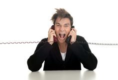 Calling angry, furious young man Stock Photos
