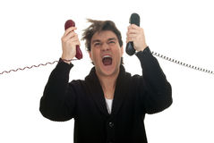 Calling angry, furious young man Stock Photography