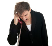 Calling angry, furious young man Royalty Free Stock Image
