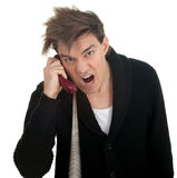 Calling angry, furious young man Stock Photo