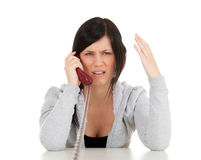 Calling angry young woman Royalty Free Stock Photo