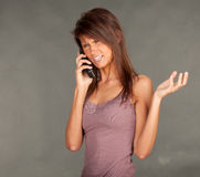Calling angry young woman Royalty Free Stock Images