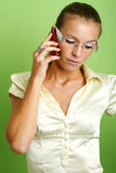 Calling business woman. Business portrait of a young and successful woman is calling with a mobilephone Stock Photography