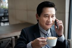 Calling businessman stock photos