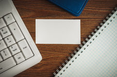 Calling card on the wooden desk Stock Photography