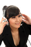 Calling center. Career woman wearing headset on white Royalty Free Stock Photography