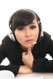 Calling center. Career woman wearing headset on white Stock Image