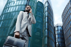 Calling in the city. Young agent calling client to make appointment Royalty Free Stock Images