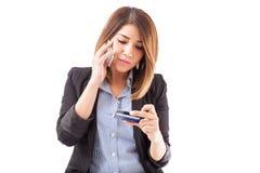 Calling customer support at a bank Stock Photo