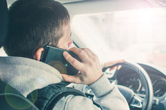 Calling by driving. Risky driver using phone while driving.  Stock Images