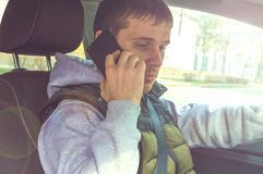 Calling by driving. Risky driver using phone while driving.  Royalty Free Stock Photography