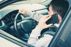 Calling by driving. Risky driver using phone while driving.  Stock Photo