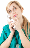 Calling female doctor looking up Stock Images