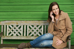 Calling Friends on Mobile Phone Stock Image