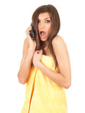 Calling frightened beautiful young woman Stock Photography