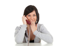 Calling frightened young woman Royalty Free Stock Image