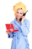 Calling girl in bathrobe with present box Royalty Free Stock Photo