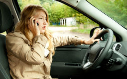 Calling girl driving her new car Royalty Free Stock Photo