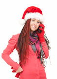 Calling girl in santa claus hat, ethnic hairstyle Stock Photos