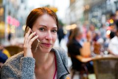Calling happy woman in city royalty free stock photo
