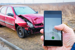 Calling for help after car crashed. Calling for help on the smartphone after car crashed Royalty Free Stock Photos