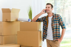 Calling from his new flat. Stock Photography