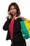 Calling home after shopping Stock Photos